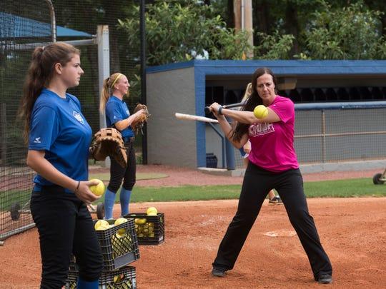 UWF Softball coach, Melissa Paul, right, gives her