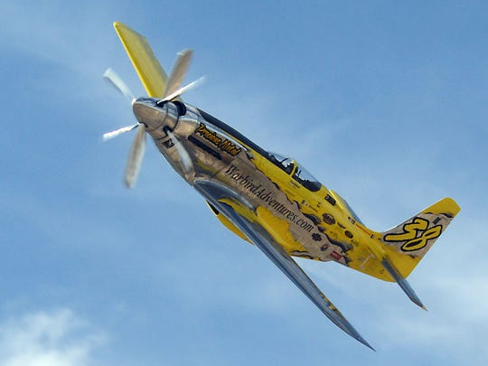 Thom Richard of Kissimmee, Fla., flies Precious Metal in a heat race at the Reno National Championship Air Races in 2014.