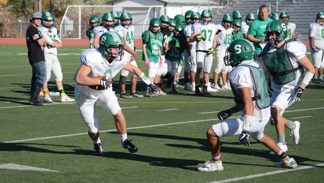 Farmington's Ethan Todd, left, looks to evade tackler Gabe Medina during Tuesday's practice. The Scorpions, who clinched the District 1-5A title last week, look to go undefeated in district this year.