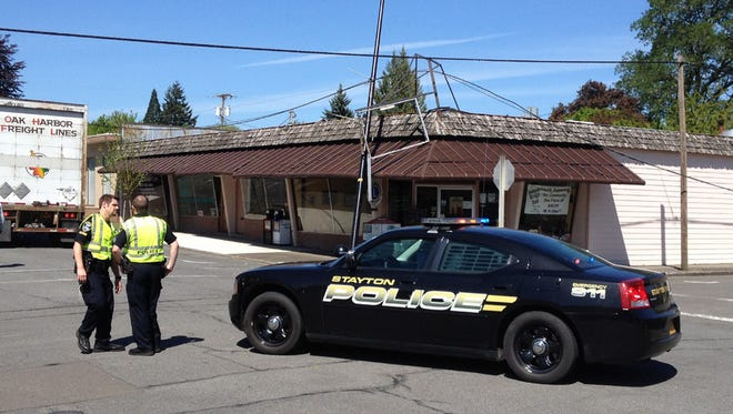 A truck turning onto 3rd Avenue in Stayton snagged overhead cables on Wednesday, April 30.