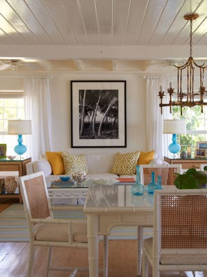 A living and dining room in a home in Harbour Island in the Bahamas decorated by interior designer Jan Showers.