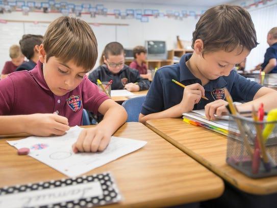 Third graders Samuel Rindt, left, and Roper White work