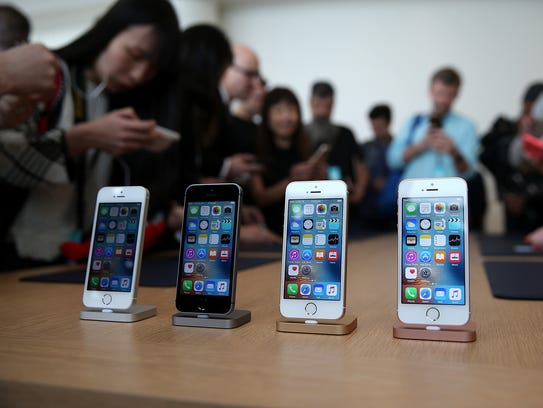 The new iPhone SE is displayed during an Apple special