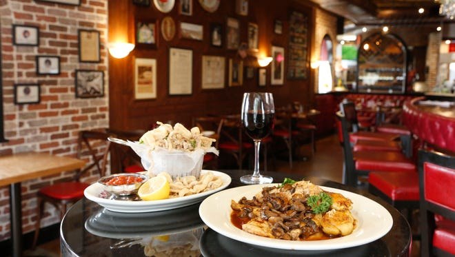Crispy calamari with marechiara sauce and chicken marsala with broccoli rabe at Lincoln Lounge in Mount Vernon, Sept. 22, 2015.