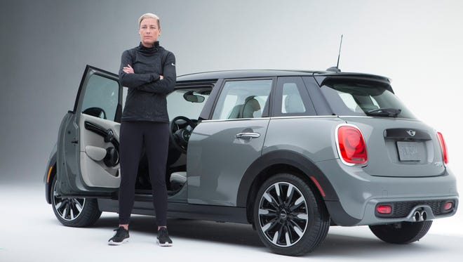 Abby Wambach poses in a MINI ad.
