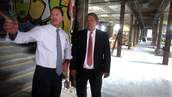 Guy Leibler, president of Simone Healthcare Development, speaks with Yonkers Mayor Mike Spano inside the former Boyce-Thompson Institute in Yonkers.