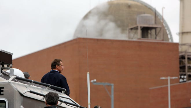 Gov. Andrew Cuomo surveys the oil spill at Indian Point in Buchanan on Sunday.