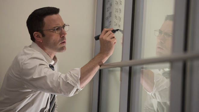 """Ben Affleck appears in a scene from """"The Accountant."""""""