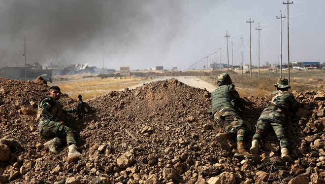 Kurdish security forces take up a position as they fight overlooking the Islamic State-controlled in villages surrounding Mosul, in Khazer, on Oct. 17, 2016. Iraqi government and Kurdish forces, backed by U.S.-led coalition air and ground support, launched coordinated military operations.