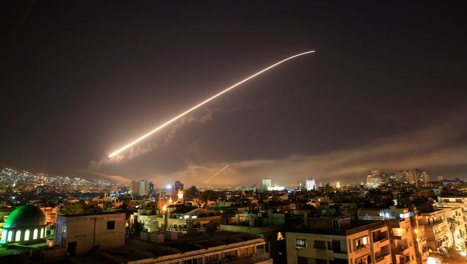 Damascus sky lights up with surface-to-air missile fire as the U.S. launches an attack on Syria targeting different parts of the Syrian capital Damascus, Syria, early Saturday, April 14, 2018. Syria's capital has been rocked by loud explosions that lit up the sky with heavy smoke as U.S. President Donald Trump announced airstrikes in retaliation for the country's alleged use of chemical weapons.