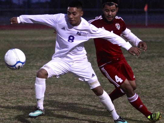 Shadow Hills' Joshua Lopez (8) attempts to evade Desert Mirage's Juan Ceja (4) during a home match on Tuesday.