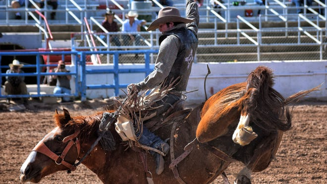 New Mexico State University rodeo athlete Blaise Milligan rides his bucking horse during the Tucson college rodeo this season.
