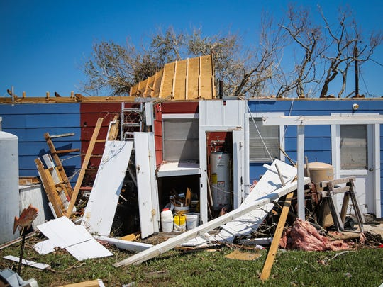 Remains of a house stand Wednesday, Aug. 30, 2017, after Hurricane Harvey winds blew the roof off in Lamar.