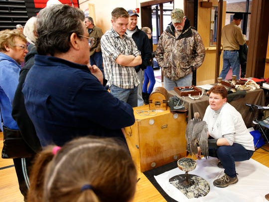 Normajean Albright, falconer and owner of MorganEagle Falconry, talks to a crowd at the Spencer-Van Etten Sportsman Club Show Saturday about Kyra, a 2-year-old lanner falcon.