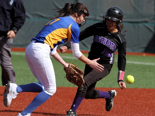 Bloomfield's Ashley Lewellen fields the ball as Miyamura's Bailey Pete reaches second base on Tuesday at the Bloomfield Softball Complex.