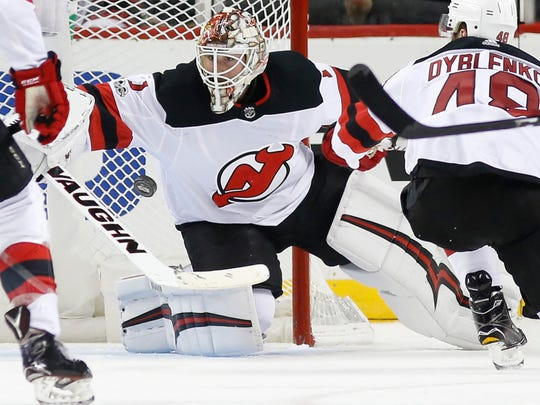 New Jersey Devils goalie Keith Kinkaid (1) makes a save during the third period of a preseason NHL hockey game in New York, Monday, Sept. 25, 2017. The Islanders shut out the Devils 3-0. (AP Photo/Kathy Willens)
