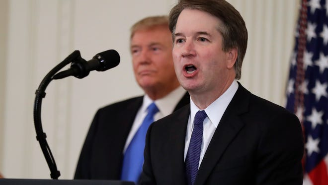 Judge Brett Kavanaugh and President Donald Trump on July 9 at the White House.