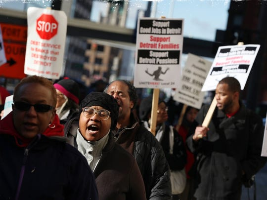 Hundreds of rally in front of the federal courthouse in Detroit during a bankruptcy hearing on Oct. 23, 2013. City pensioners and workers eventually agreed to cuts made smaller by the grand bargain.