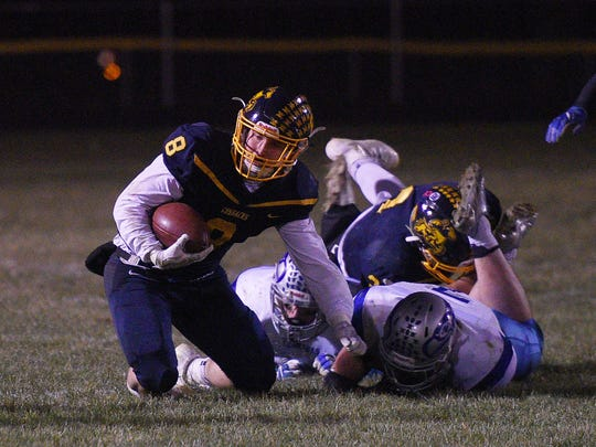 Sioux Valley's Daymein Lucas pushes the ball past Bridgewater-Emery-Ethan's defense Friday, Nov. 3, in Volga.