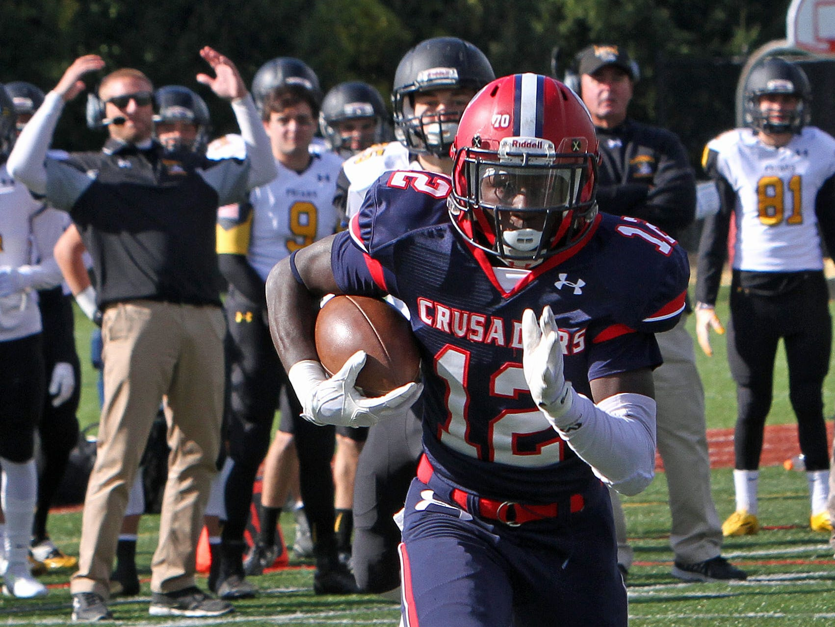 Stepinac's Atrilleon Williams (12) intercepts a pass and runs in for a first half touchdown against Saint Anthony's in a football game at Stepinac High School in White Plains Oct. 17, 2015. Stepinac won the game 49-32.
