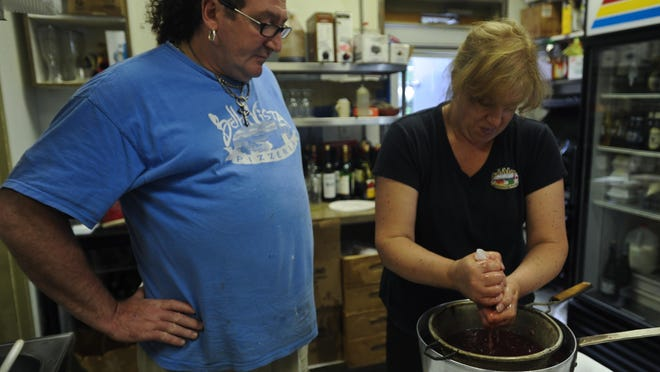 Candace Roseo and her husband Nunzio, are shown in 2011 making a homemade strawberry liqueur at BellaVista Trattoria & Pizzeria in Pike Creek. The business was closed on Wednesday.