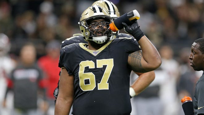 Oct 6, 2019; New Orleans, LA, USA; New Orleans Saints offensive guard Larry Warford (67) get a drink during a timeout in the second half against the Tampa Bay Buccaneers at the Mercedes-Benz Superdome. Mandatory Credit: Chuck Cook-USA TODAY Sports