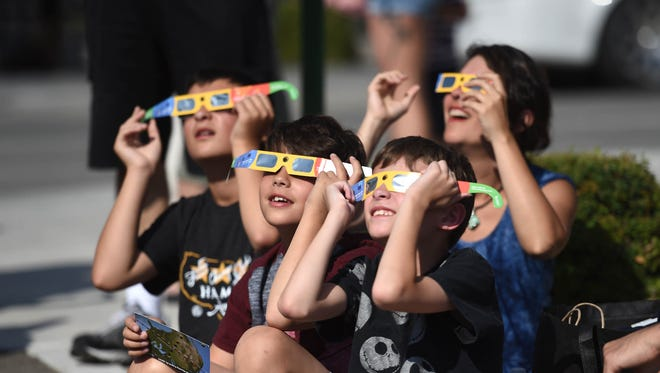 People watch the eclipse at the Terry Lee Wells Nevada Discovery Museum downtown Reno on Aug.21, 2017.