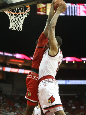 Louisville's Steven Enoch, left, blocks a shot by Malik Williams during the team's first scrimmage practice. Oct. 13, 2017