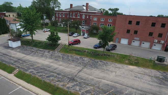 Current state of the back lot where Mill Pond Terrace will soon be constructed.
