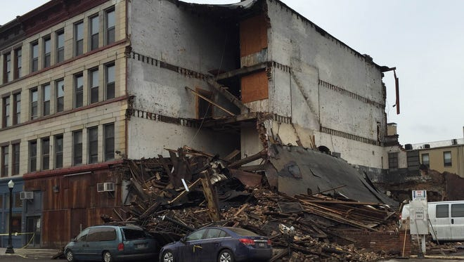 No injuries were reported when the four-story building at 126 W. Court St. collapsed on Saturday night. Crews continued to clear debris from the scene on Sunday morning.