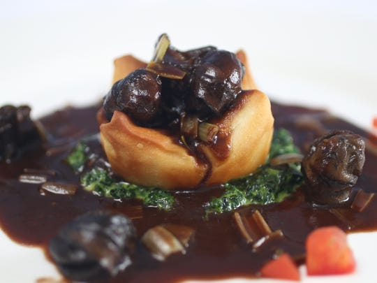 Escargots a la bourguignonne is shown at Latour in Ridgewood. Tuesday, July 31, 2018