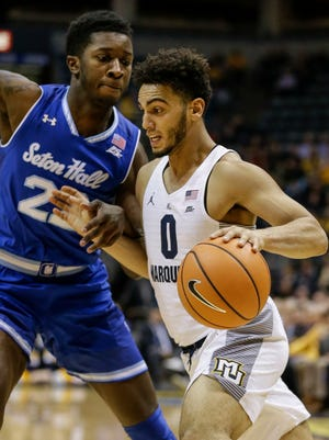 Marquette's Markus Howard (0) drives on Seton Hall's Myles Cale during a game Tuesday.