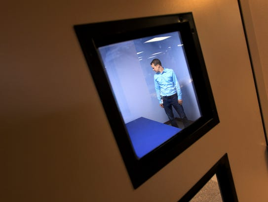 Supervisor Jacob Henry stands in a safe room at the