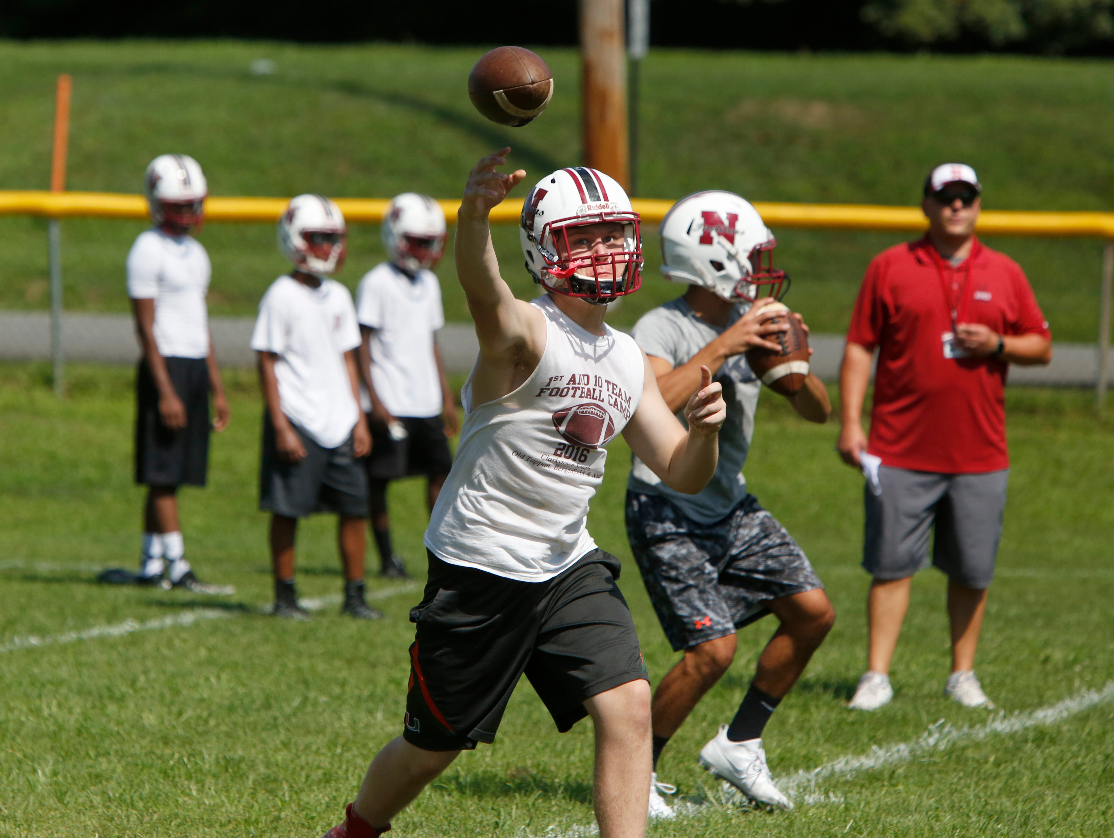 Nyack High School sophomore Parker Stemkowski, left, and senior Christian DiSimone work on passing drills during the first day of football practice Aug. 15, 2016 at Nyack Middle School.