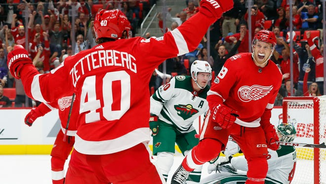 Detroit Red Wings' Anthony Mantha (39) celebrates his goal with Henrik Zetterberg, of Sweden (40) against the Minnesota Wild in the second period of an NHL hockey game Thursday, Oct. 5, 2017, in Detroit.