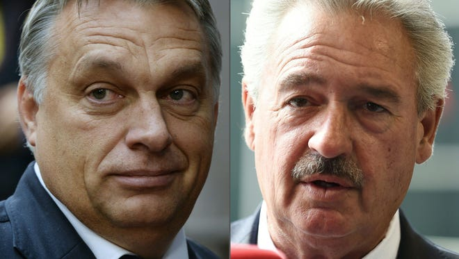"""(COMBO) This combination of pictures created on Sept. 13, 2016 shows Hungarian Prime Minister  Viktor Orban (left), on Oct. 15, 2015 in Brussels) and Luxemburg's Foreign Minister Jean Asselborn on April 18, 2016 in Luxembourg.  Luxembourg's Foreign Minister Jean Asselborn said on September 13, 2016 Hungary should be suspended from the European Union for violating democratic core values and treating refugees like """"animals"""". / AFP PHOTO / THIERRY CHARLIER AND JOHN THYSTHIERRY CHARLIER,JOHN THYS/AFP/Getty Images ORIG FILE ID: AFP_G39BR"""