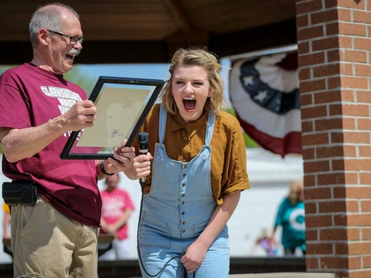 American Idol finalist Maddie Poppe laughs with Clarksville, Iowa, Mayor Val Swinton, after receiving a proclamation Tuesday, May 15, 2018, before a parade and then concert in Allison.