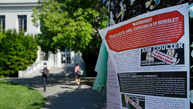 A leaflet is seen stapled to a message board near Sproul Hall on the University of California at Berkeley on Friday, April 21, 2017, in Berkeley, Calif.