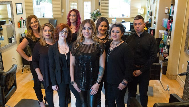 Veronica Archuleta, owner of The Mint Hair Studio & Med Spa, poses with her staff at their new location, 665 E. University Ave., Ste. B. Wednesday November 1, 2017.