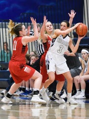 Sioux Falls Christian guard Lexi Unruh (3) is defended