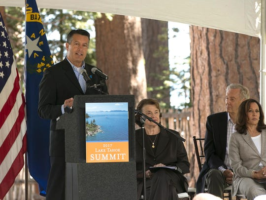 Nevada Gov. Brian Sandoval, left, speaks at the 21st Annual Lake Tahoe Summit, Tuesday, Aug. 22, 2017, in South Lake Tahoe, Calif. The summit is gathering of federal, state and local leaders to discuss the restoration and sustain Lake Tahoe. Also seen are from left, are Democratic U.S. Senators Dianne Feinstein, center, Kamala, Harris, right, and former Secretary of the Interior Bruce Babbitt, second from right.(AP Photo/Rich Pedroncelli)