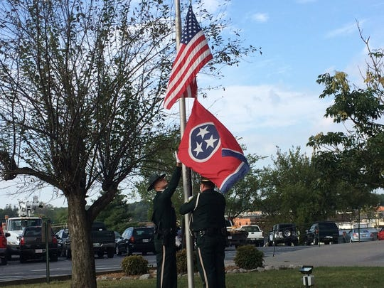 Deputies lower the flag during the 9/11 Memorial Service