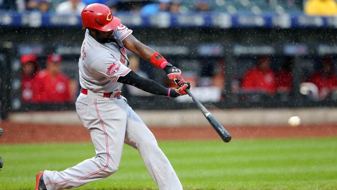 Brandon Phillips connects on an RBI double against the Mets at Citi Field Saturday before the game was postponed.