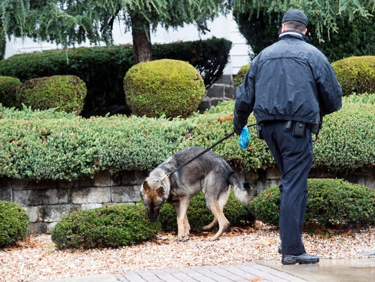 A Pennsylvania State Police officer walks a bomb dog