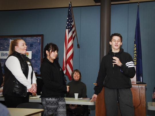 From left, Rotary exchange and scholarship students Allison Peterson, 17; Mariah Reed, 17; and Thomas Gniadecki, 16, speak to the gathered membership of the Rotary Club of Dallas at the club's regular Tuesday, noon, meeting at the Dallas Civic Center while club president Mia Mohr watches.