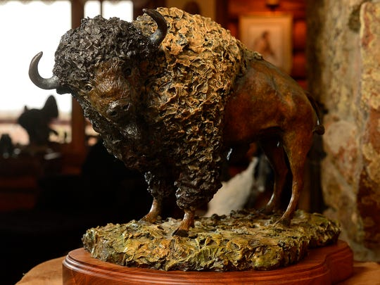 """""""A Great Bull of the Prairie"""" sits at Don Ream's home in Great Falls."""