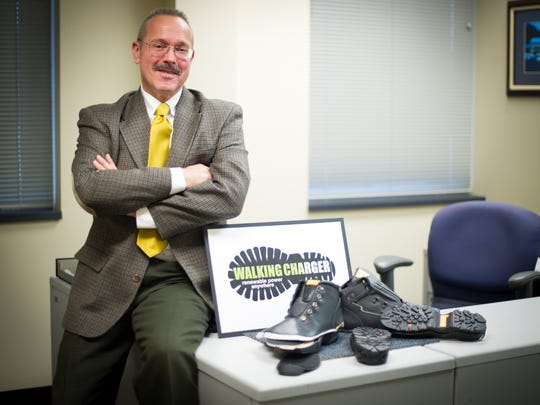 Energy Harvesters CEO Larry Grumer with prototypes of the Walking Charger, which allows users to charge the batteries in their mobile electronic devices, anytime, anywhere, just by walking.