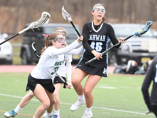 Mahwah at Pascack Valley on Saturday, April 7, 2018. (right) M #46 Haley Doran and PV #3 Jamie Bader.