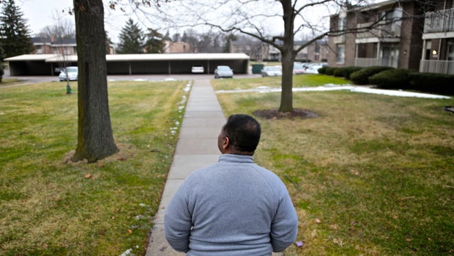 """Robertson goes for a walk at his apartment complex in Troy. How much weight did he gain? He won't say. """"It's too much, I know,"""" he said."""