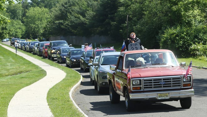 The PeopleÕs Motorcade from Ten Eyck Park in Branchburg passing outside Donald TrumpÕs Bedminster golf club, where the President held a fundraiser for Congressman Tom MacArthur to highlight their opposition to the MacArthur/Trump amendments to the American Health Care Act and the elimination of affordable and accessible healthcare for 23 million Americans. June 11, 2017, Bedminster, NJ.